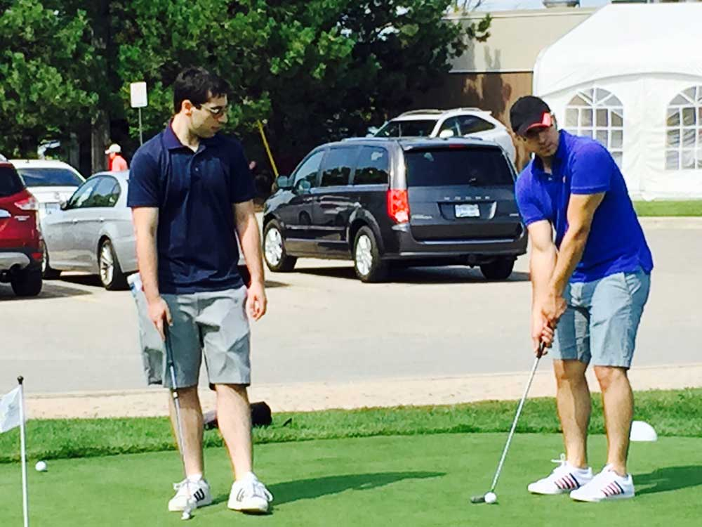 Tenants and staff of 4646 Dufferin St. paying golf at event